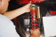 Motorcycle Mechanic Check And Change Rear Shock Absorber Big Scooter ,motorcycle Maintenance And Service And Repair Concept In Garage