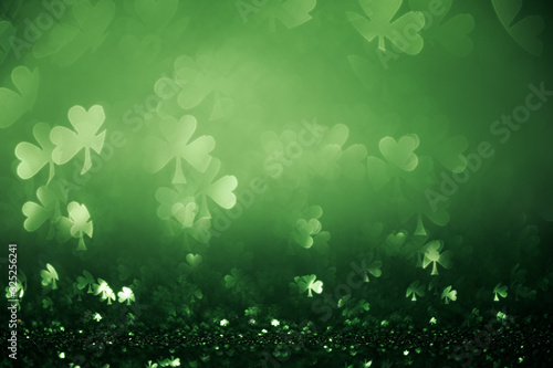 Fotografía Green St Patricks day background with sparkling shamrock shapes