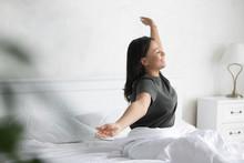Overjoyed Biracial Woman Wake ...