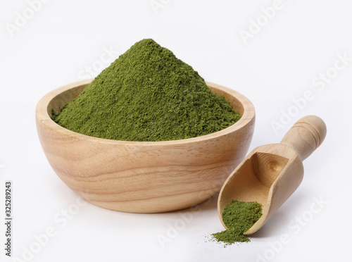 Fototapeta Matcha green tea powder in bowl isolated on white background, Organic product from the nature for healthy with traditional style obraz