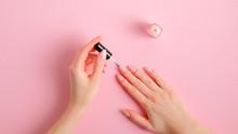 Woman Applying Polish On Nails...