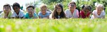Happy Children Lie On The Gree...