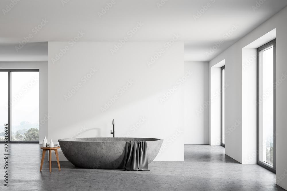 Fototapeta Spacious white bathroom with stone tub