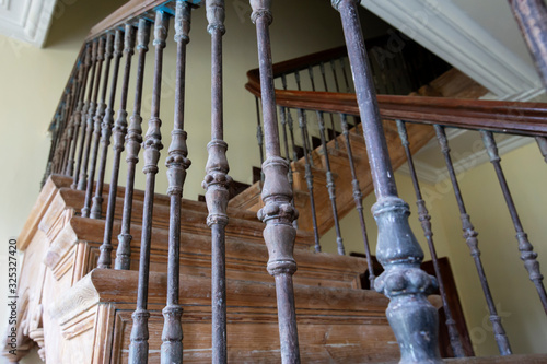 Ancient staircase with iron balusters . Wallpaper Mural