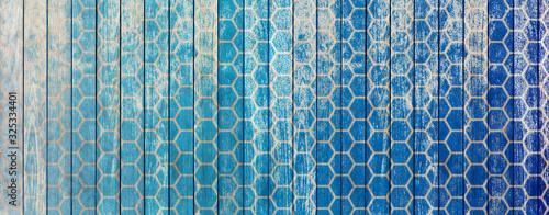 Photo Formes alvéolaires sur fond bois bleu vintage