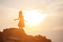 Silhouette Of Woman Praying Ov...