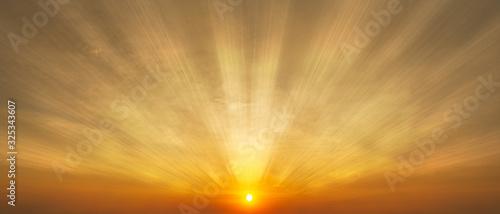 Fototapeta Gorgeous panorama scenic of the sunrise with sunlight and cloud on the orange sky obraz na płótnie