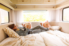 Teenager Reading Book In Caravan
