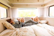 Teenager Reading Book In Caravan