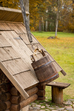 Traditional European And Slavic Rural Life: Rustic Old Wooden Well, Bucket And Bench; Agriculture Tourism Concept; Russian Countryside