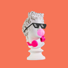 Statue On A Pink Background. Gypsum Statue Of Apollo Head. Man. Creative. Plaster Statue Of Apollo Head In Pixel Glasses. Minimal Concept Art.