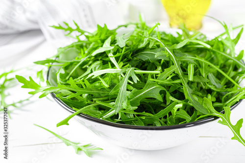 Photo Fresh arugula or rocket leaves salad, rucola