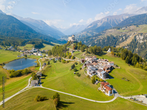 Fotografie, Obraz Aerial view of Castle Tarasp (built in the 11th century) in Swiss Alps, Canton G