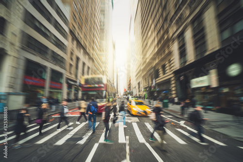 Blurred Crowd of unrecognizable business people walking on Zebra crossing in rush hour working day, New York, United States, blur business and people, lifestyle and leisure of Pedestrian concept