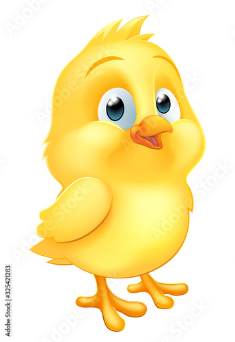 Fotografering An Easter chick little yellow baby chicken bird cartoon character