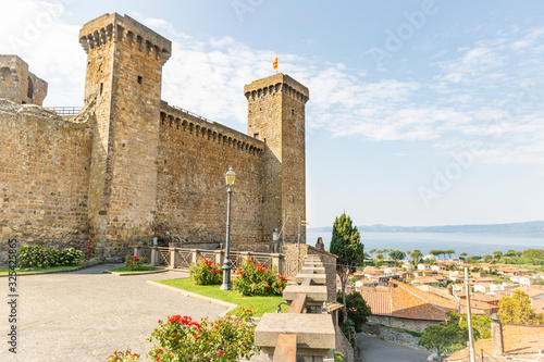 The Castle and a view over the lake and the town of Bolsena, province of Viterbo Wallpaper Mural