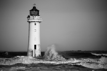 Black and white lighthouse in a storm