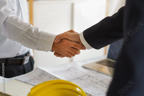 Businessman collaborate with partner, worker or customer to agree, sign contact, deal to expand their business investment network and building project development Canvas Print