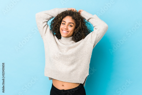 Young african american curly hair woman stretching arms, relaxed position Canvas Print