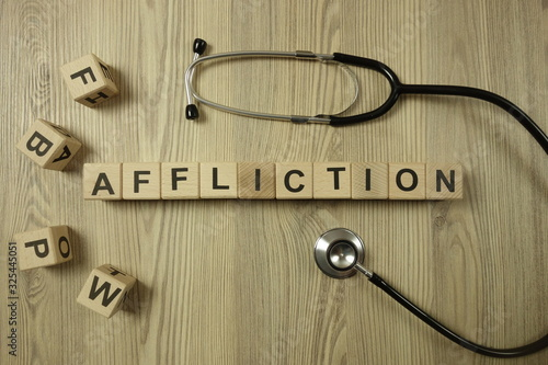 Word affliction from wooden blocks with stethoscope Wallpaper Mural