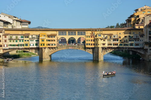The famous bridge Ponte Vecchio in Florence over the river Arno Wallpaper Mural