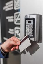 Man Scanning Security Key Card...