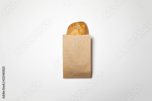 Photographie Fresh Bread in a brown kraft Paper Bag Mockup on white background