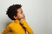 Small Black Kid Boy Thinking A...