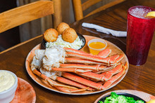 Crab Legs With Hushpuppies And...