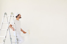 A Male Painter In A White Unif...