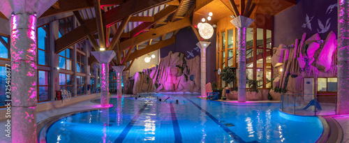 Photo Swimming pool with ambience and lights in a sport center in Les Menuires