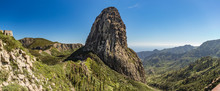 Panoramic View Of Agando Rock In La Gomera Island. A Volcanic Plug, Also Called A Volcanic Neck Or Lava Neck, Is A Volcanic Object Created When Magma Hardens Within A Vent On An Active Volcano