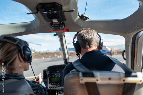 Fotografie, Tablou Preparing for helicopter ride with pilot and copilot