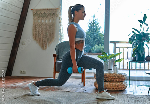Fotografie, Obraz Woman doing exercises at home.