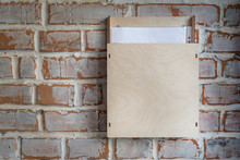 Old Vintage Brick Wall With Plywood Box For Anonymous Paper Notice, Feedback, Suggestion , Opinions And Compliants At Store Or Cafe. Customer Communication Dropbox For Improvement Of Service