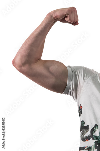 Strong muscular biceps muscle of a man, wearing a white shirt isolated on a white background Wallpaper Mural