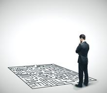 Businessman Looking At Labyrinth.