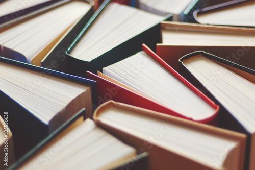 Photo Many hardbound books background, selective focus
