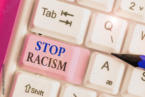 Photo Writing note showing Stop Racism