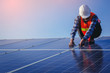Electrical, instrument technician use wrench for fix and maintenance electrical system at solar panel field