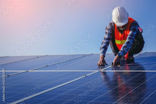 Obraz Electrical, instrument technician use wrench for fix and maintenance electrical system at solar panel field - fototapety do salonu