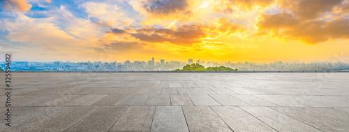 Fototapeta Wide square floor and city skyline at sunrise in Hangzhou,China. obraz