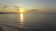 AERIAL: Golden sunrise over ocean bay