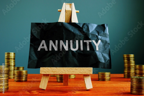 Photo Annuity sign on the black sheet ans coins.