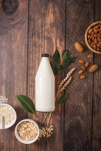 Plant vegan milk in bottle with ingredients Papier Peint