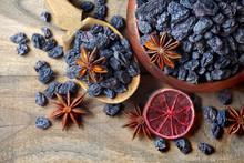 Black Raisins In A Bowl On A W...