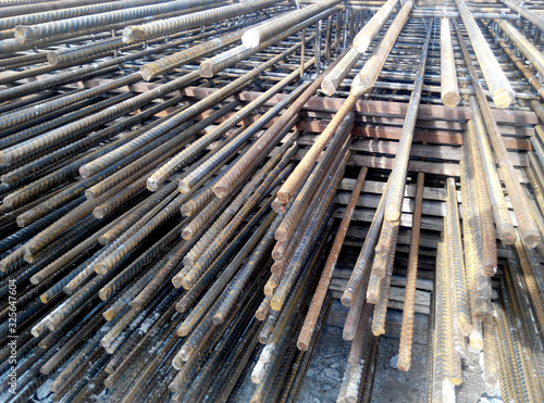 Valokuva Hot rolled deformed steel bars or steel reinforcement bar tied together before cast in the concrete