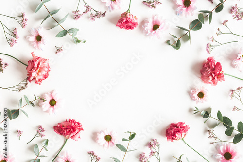 Fototapeta Flowers composition. Frame made of pink flowers and eucalyptus branches on white background. Valentines day, mothers day, womens day concept. Flat lay, top view obraz