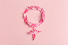 Gender Venus Symbol Made Of Beautiful Flower Petals On Candy Pink Background, Woman Sign