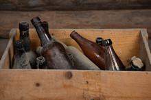 Old Dusty Bottles In A Wooden ...